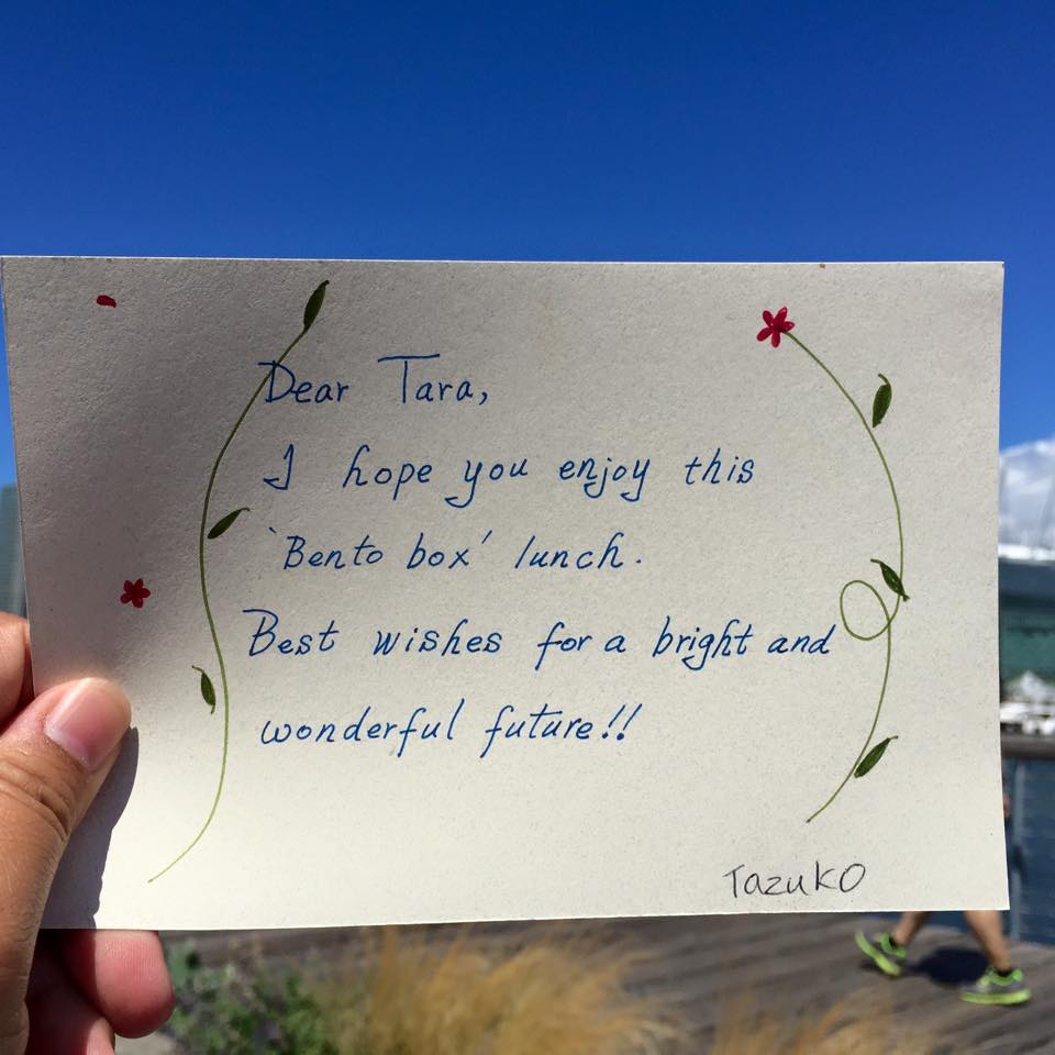 """Handwritten note: """"Dear Tara, I hope you enjoy this 'Bento box' lunch. Best wishes for a bright and wonderful future!! Tazuko"""""""